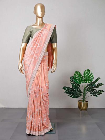 Latest peach designer silk wedding wear saree