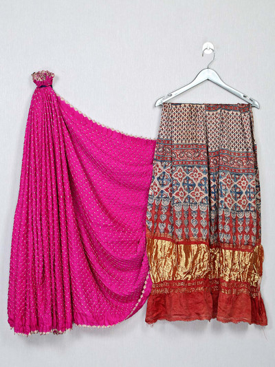 Magenta and red color bandhej saree for festivals