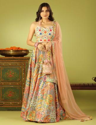 A charming peach hue wedding lehenga choli with odhani