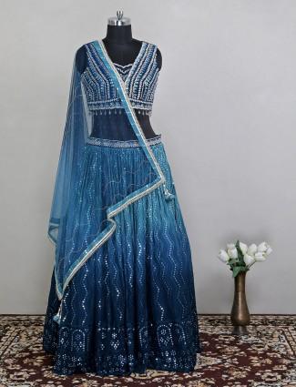 A charming peacock blue hue wedding lehenga with odhani