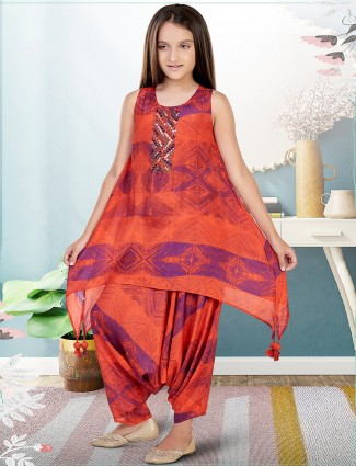 A rust orange wedding sessions girls dhoti suit in georgette