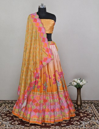 A sequins work printed ochre yellow unstitched lehenga choli for women