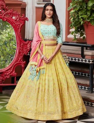 A yellow hue wedding lehenga with contrast hue dupatta