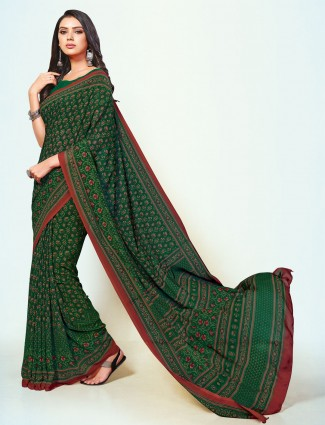 Absorbing printed green georgette saree