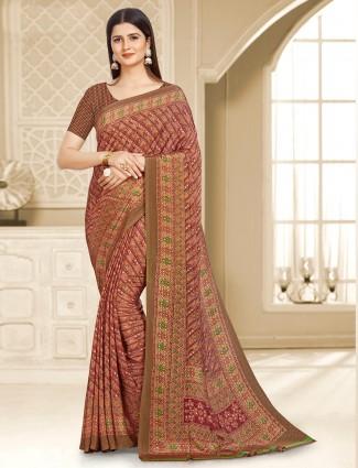 Absorbing printed maroon crepe saree