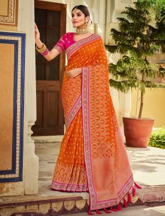 Alluring orange shade silk saree for feminism