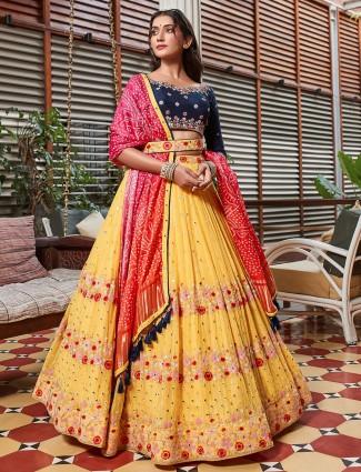 Alluring wedding wear bright yellow lehenga with contrast shade odhani