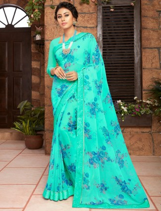 Amazing aqua blue floral saree for festive look