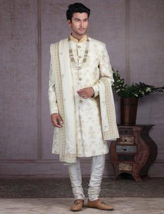 Amazing cream net sherwani for wedding