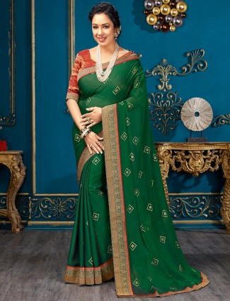 Amazing dark green chiffon festive wear saree