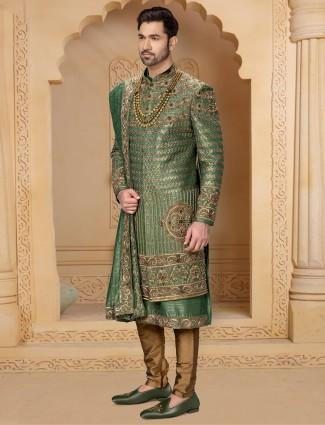 Amazing dark green double layer raw silk sherwani