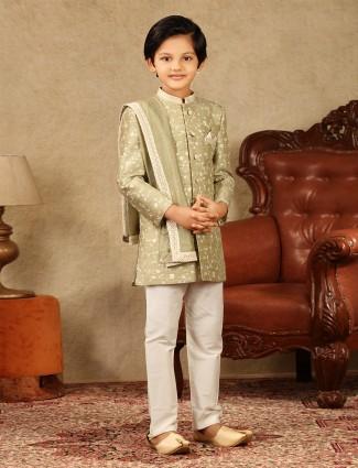 Amazing green raw silk sherwani for boys