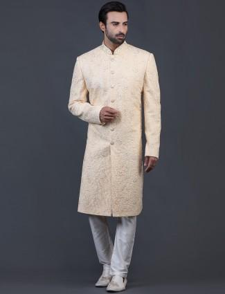 Amazing yellow net sherwani for wedding