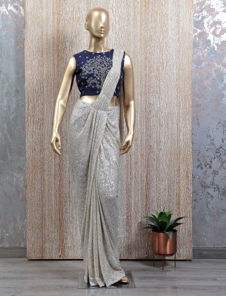 An extravagant silver tint ready to wear saree with readymade blouse