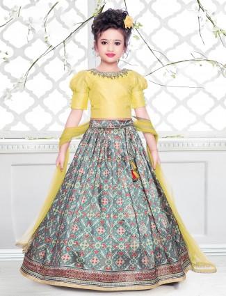 An yellow patola style cotton silk lehenga for little girls