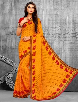 Attirable yellow printed chiffon bandhani saree for festive