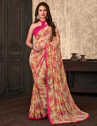 Attractive cream printed georgette saree for festive