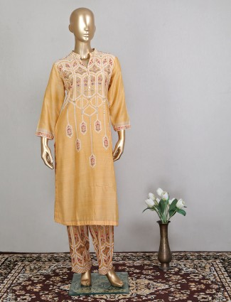Attractive yellow cotton pant style suit for festive wear