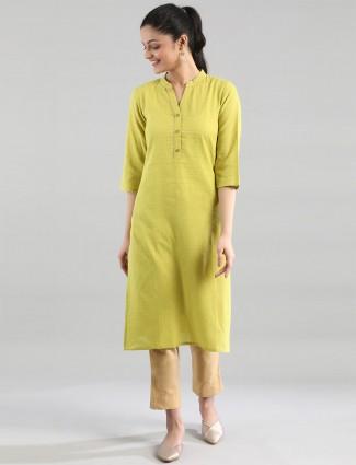 Aurelia lime green solid cotton casual wear kurti