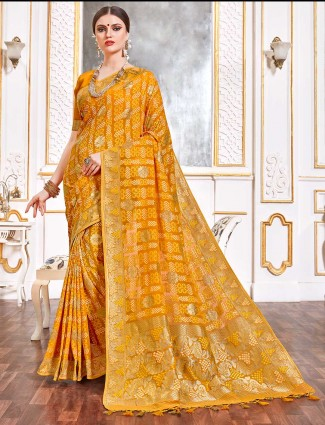Bandhej mustard yellow saree in georgette for reception