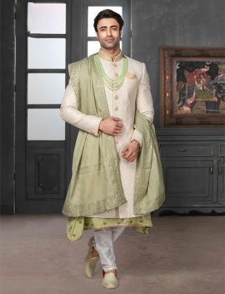 Beautifully patterned cream silk sherwani
