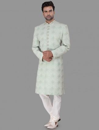 Beautifuly embroidered green chikan silk sherwani