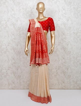 Beige colour bandhej style saree for festive