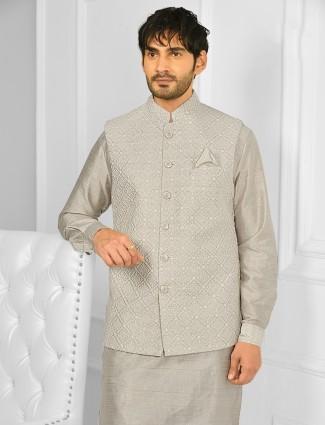 Beige colour cotton silk waistcoat set with chudidar