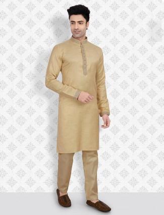Beige hued solid cotton kurta suit