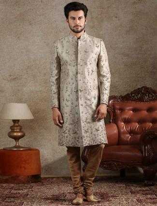 Beige raw silk fabric sherwani for wedding occasions