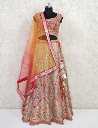 Beige wedding wear lehenga in net