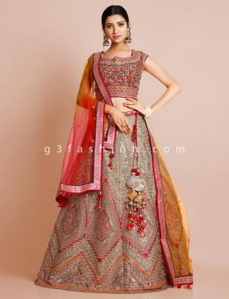 Beige wedding wear net lehenga with sequins details