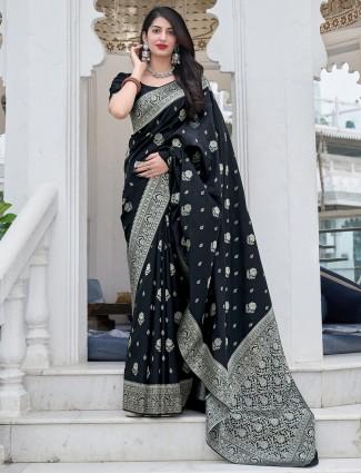 Black color spectacular banarasi silk wedding functions saree