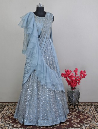 Blue net floor length gown with draped odhani pattern