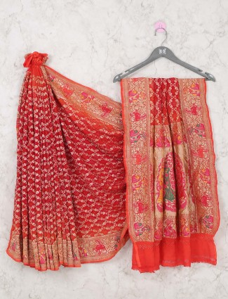 Bridal wear red colored saree in bandhej
