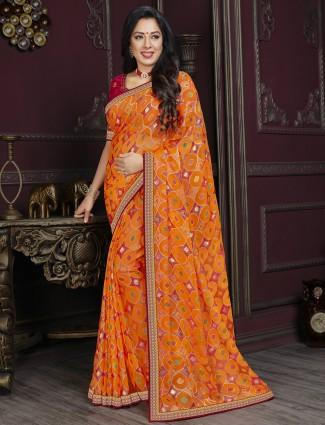 Carrot orange festive wear georgette saree in printed