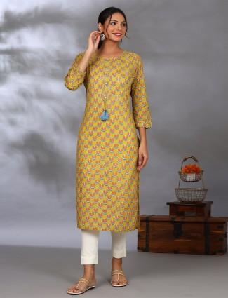 Casual wear printed kurti in charming mustard yellow hue