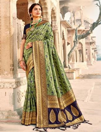 Conventional mint green banarasi silk saree for wedding session