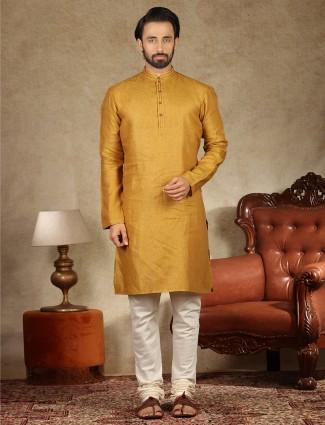 Cotton fabric mustard yellow hue stand collar kurta suit