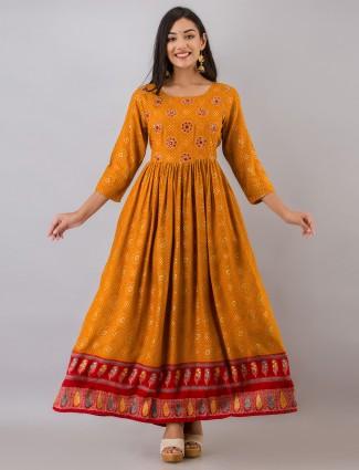 Cotton printed kurti for women in orange casual wear