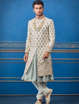 Cream designer silk groom wear sherwani