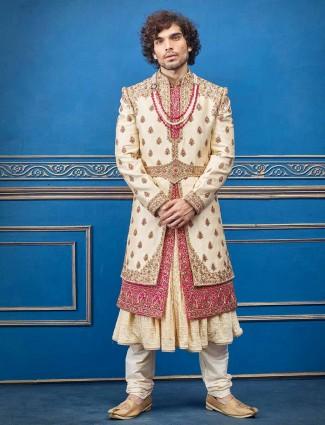 Cream magenta layer style silk groom sherwani