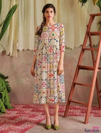 Cream printed casual wear cotton kurti for women