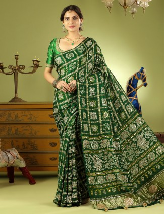Dark green bandhej wedding wear saree with ready made blouse