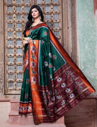 Dark green printed wedding events patola silk saree