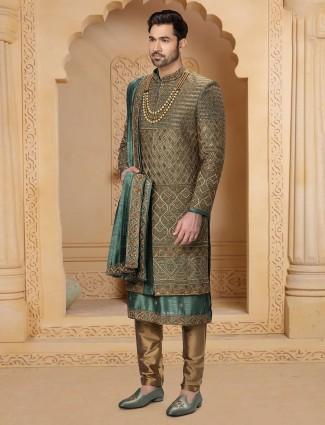 Dark green raw silk fabric sherwani for wedding