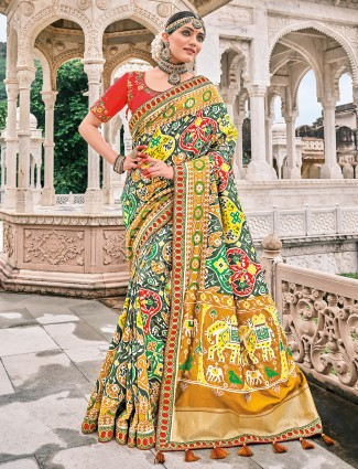 Pine green traditional wedding occasions patola silk saree