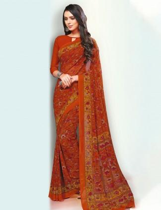 Dashing orange festive wear georgette saree