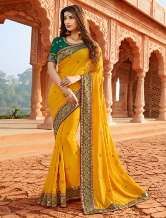 Designer latest yellow silk saree for festive ceremony