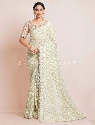 Designer pista green saree in georgette with readymade blouse